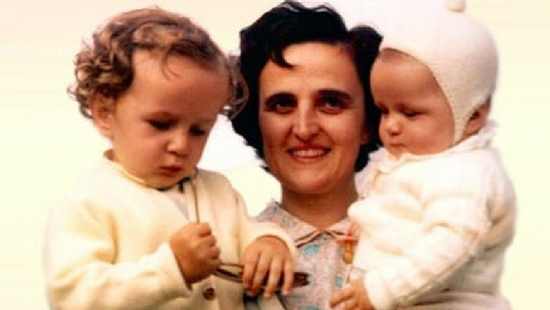 St. Gianna holding up a young child and baby