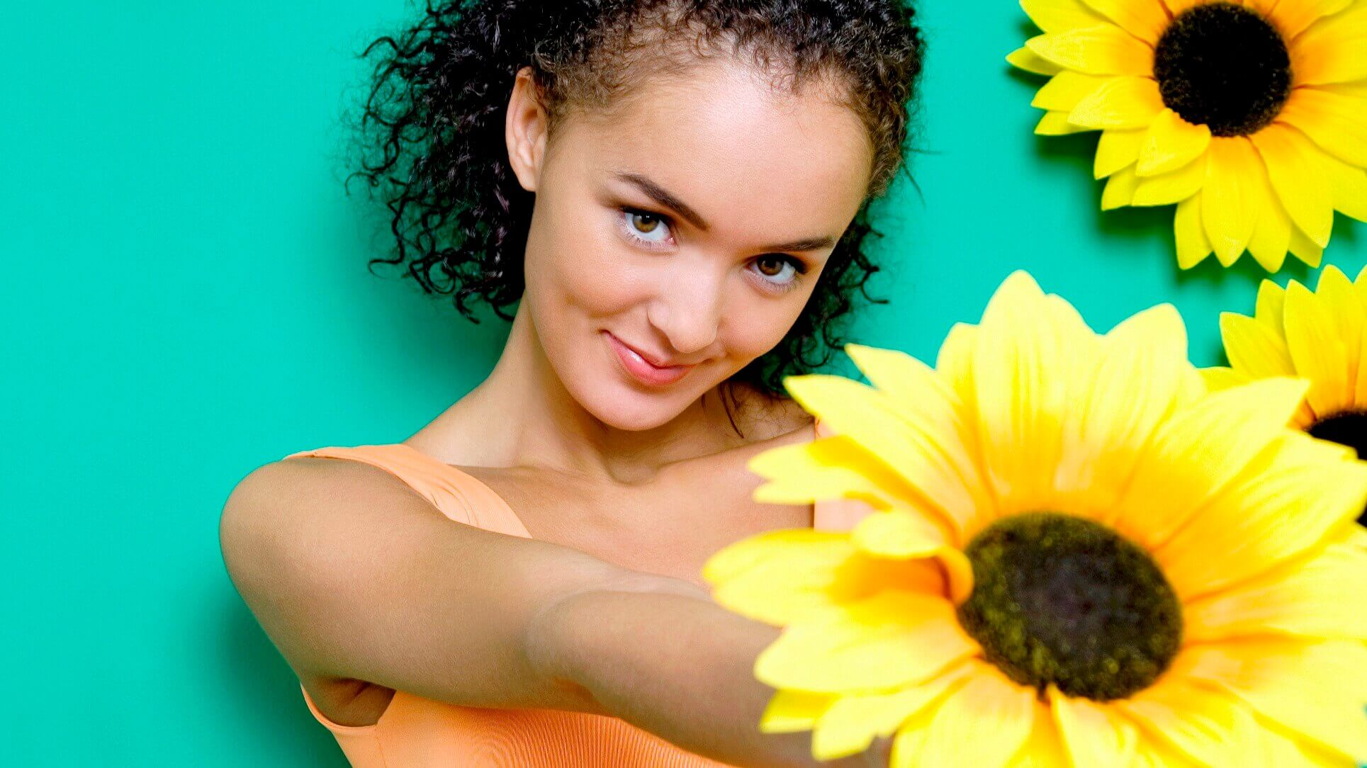 young woman holding sunflower